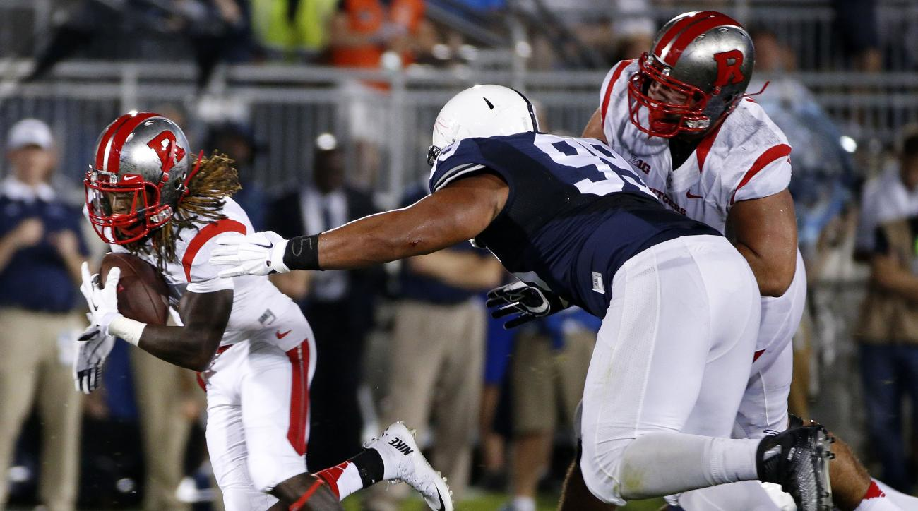 Rutgers wide receiver Janarion Grant, left, runs after catching a screen pass from quarterback Chris Laviano during the first half of an NCAA college football game against Penn State, Saturday, Sept. 19, 2015, in State College, Pa. (AP Photo/Gene J. Puska