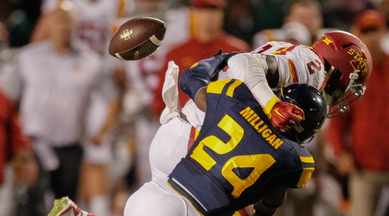Toledo free safety Rolan Milligan (24) forces Iowa State running back Mike Warren (2) to fumble the ball during the second quarter of an NCAA football game Saturday, Sept. 19, 2015, at the Glass Bowl in Toledo, Ohio. (Jeremy Wadsworth/The Blade via AP)