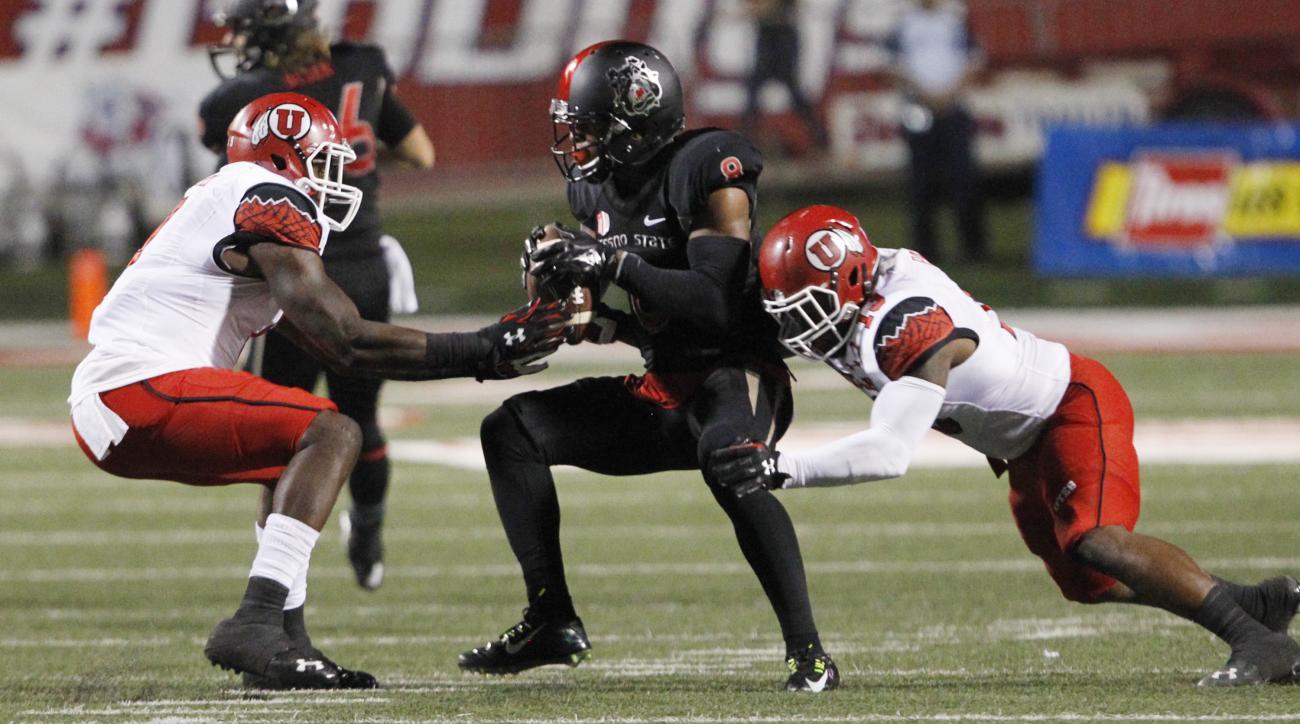 Utah linebacker Gionni Paul, right, defends against Fresno State wide receiver Da'Mari Scott during the first half of an NCAA college football game in Fresno, Calif., Saturday, Sept. 19, 2015. (AP Photo/Gary Kazanjian)