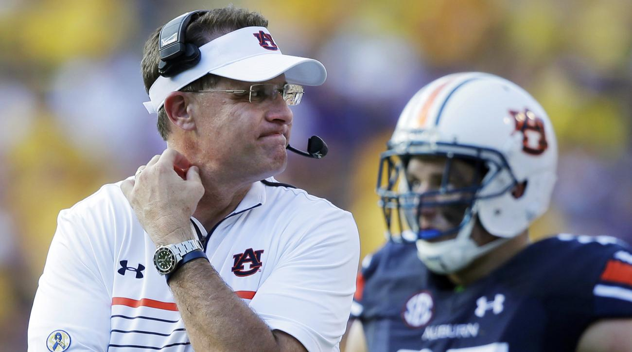 FILE - In this Saturday, Sept. 19, 2015, file photo, Auburn head coach Gus Malzahn reacts in the second half of an NCAA college football game against LSU in Baton Rouge, La. The Tigers have plenty of issues to overcome if they're going to turn this season