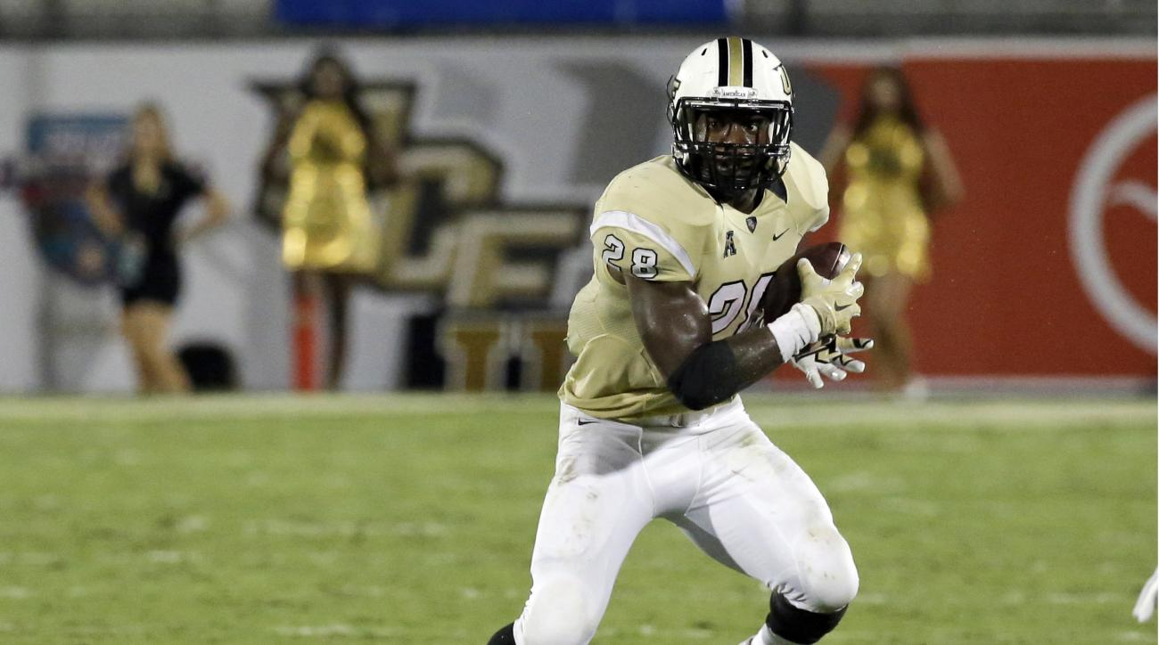 FILE - In this Sept. 3, 2015, file photo, Central Florida's William Stanback carries the ball against Florida International during the second half of an NCAA college football game in Orlando, Fla. UCF has dismissed the junior running back from the team, T