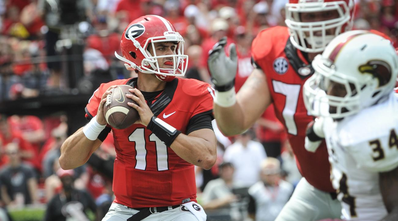 FILE - In this Sept. 5, 2015, file photo, Georgia quarterback Greyson Lambert drops back to pass against Louisiana Monroe during the first half of an NCAA college football game in Athens, Ga. Lambert set an NCAA single-game record for passing accuracy las
