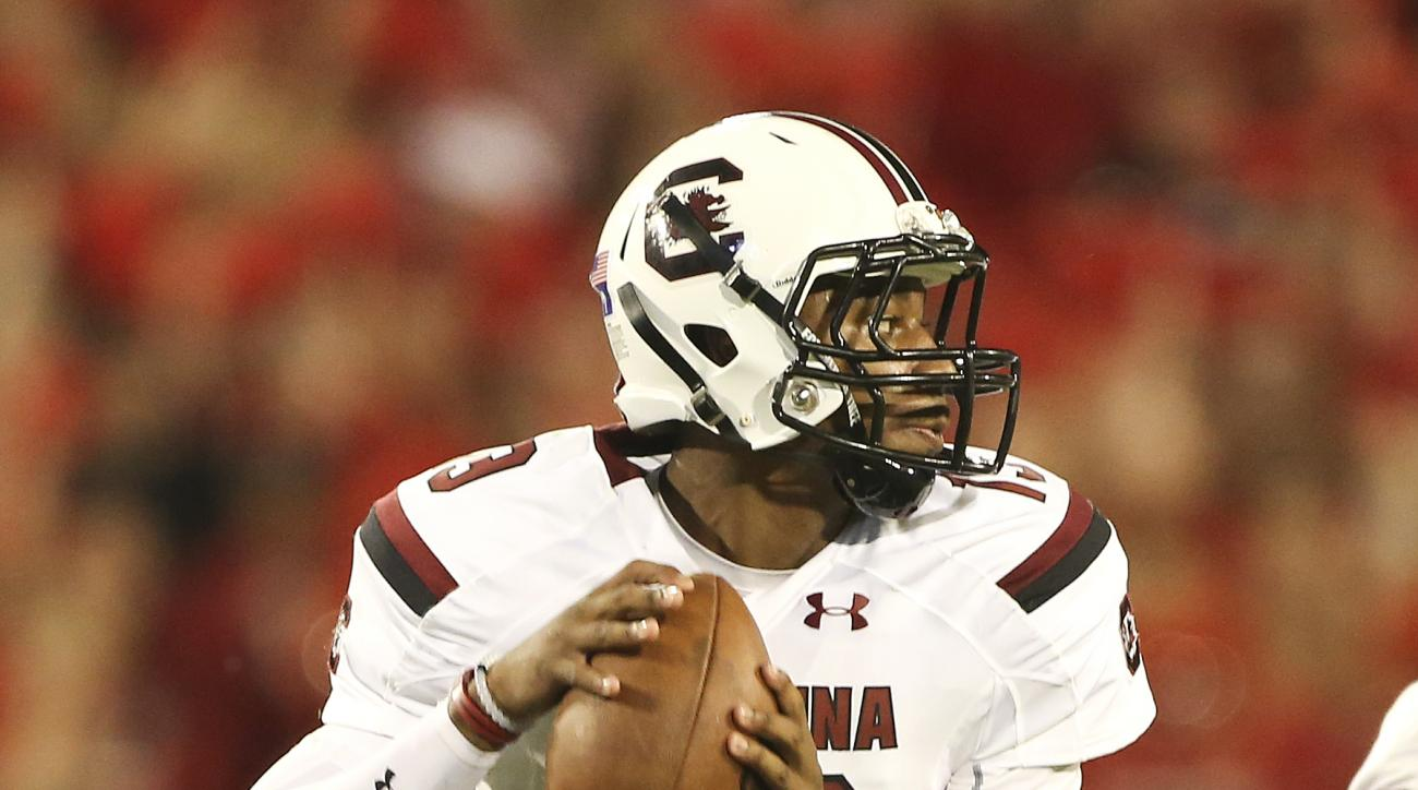 FILE- In tihs Sept. 19, 2015, file photo, South Carolina quarterback Lorenzo Nunez drops back to throw in the second half of an NCAA college football game against Georgia in Athens, Ga. South Carolina will start its third different quarterback Saturday wh
