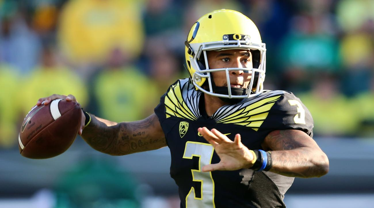 FILE- In this Sept. 5, 2015, file photo, Oregon quarterback Vernon Adams Jr. (3) looks to throw during the first half of an NCAA college football game against Eastern Washington in Eugene, Ore.  In a a Pac-12 crossover game, No. 18 Utah visits No. 13 Oreg