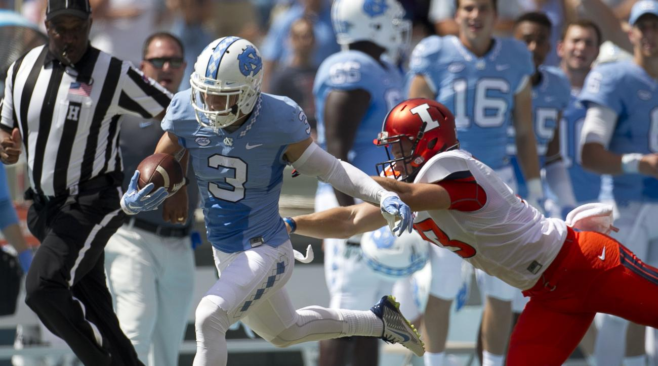 FILE - In this Saturday, Sept. 19, 2015, file photo, North Carolina's Ryan Switzer returns a punt 71-yards before being knocked out of bounds by Illinois' kicker Ryan Frain (13) in the second quarter of an NCAA college football game at Kenan Stadium in Ch