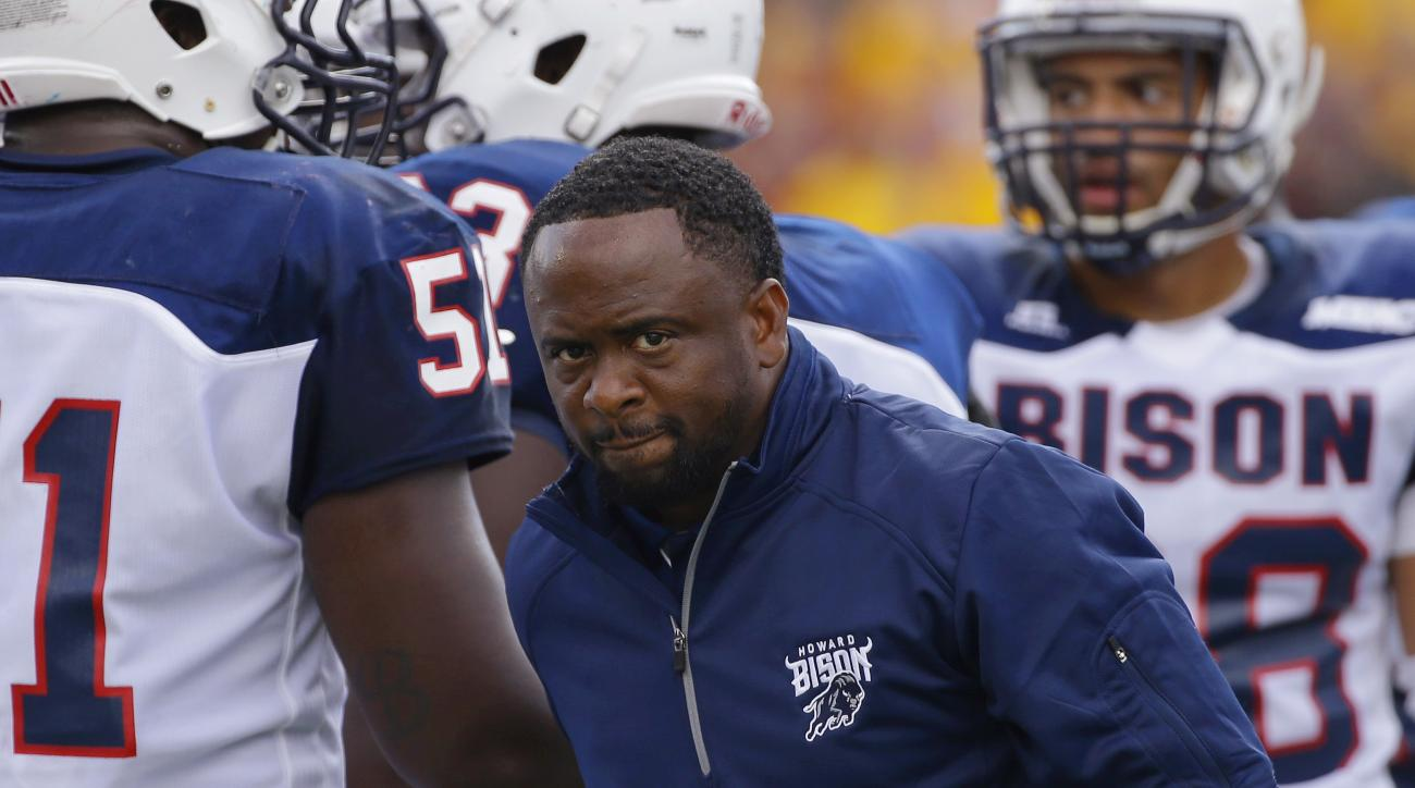 Howard head coach Gary Harrell walks among his team as they fall far behind Boston College in the first half of an NCAA college football game, Saturday, Sept. 12, 2015, in Boston, Mass. (AP Photo/Stephan Savoia)