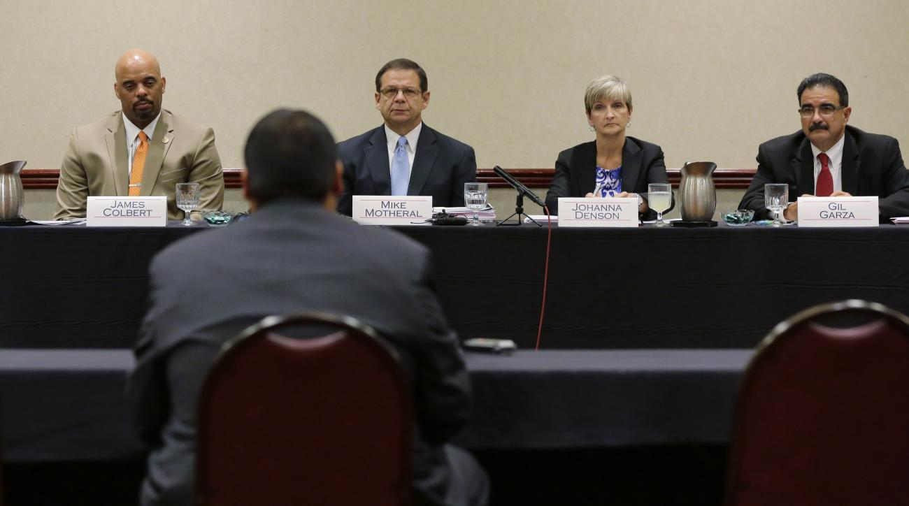 Jay High School head football coach Gary Gutierrez testifies before the University Interscholastic League (UIL) State Executive Committee, Thursday, Sept. 24, 2015, in Round Rock, Texas.  The school's principal and Gutierrez told the UIL, the governing bo