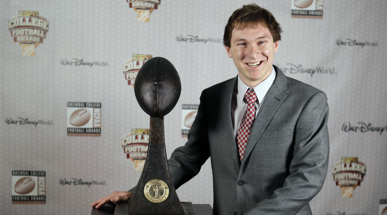FILE - In this Dec. 11, 2014, file photo, Maryland's Brad Craddock stands with his trophy after being awarded the Lou Groza Collegiate Placekicker Award at the College Football Awards in Lake Buena Vista, Fla. West Virginia's Josh Lambert and Maryland's B