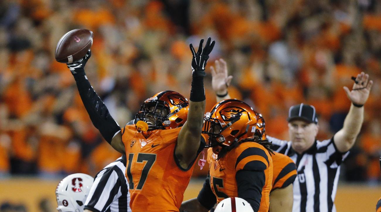 Oregon State's Cyril Noland-Lewis celebrates after intercepting a Stanford pass during the first half of an NCAA college football game in Corvallis, Ore., Friday, Sept. 25, 2015. (AP Photo/Timothy J. Gonzalez)