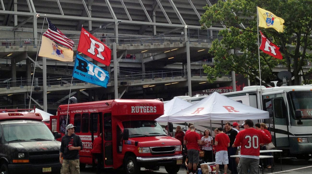Rutgers fans tailgate before an NCAA college football game against Kansas, Saturday, Sept. 26, 2015, in Piscataway, N.J. Entering the Big Ten was supposed to make everything better for Rutgers. Instead, the athletic department has taken one  embarrassing