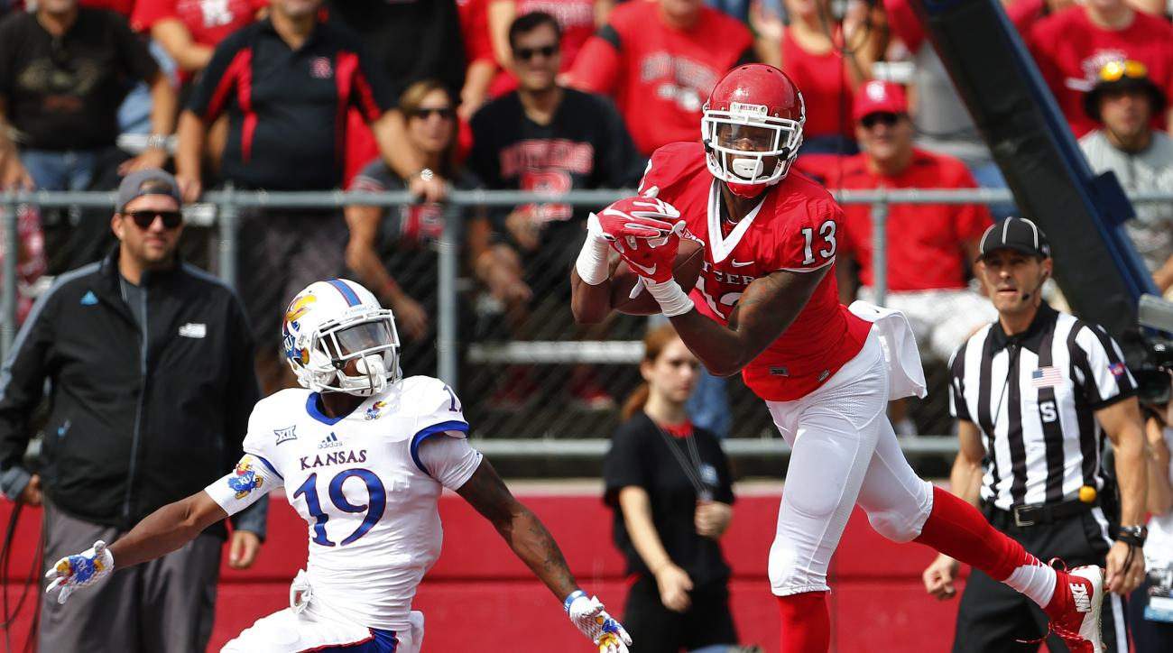 Rutgers wide receiver Carlton Agudosi (13) makes a touchdown catch against Kansas defender Tyrone Miller, Jr. (19) during the first quarter of an NCAA college football game, Saturday, Sept. 27, 2015, in Piscataway, N.J. (AP Photo/Rich Schultz)