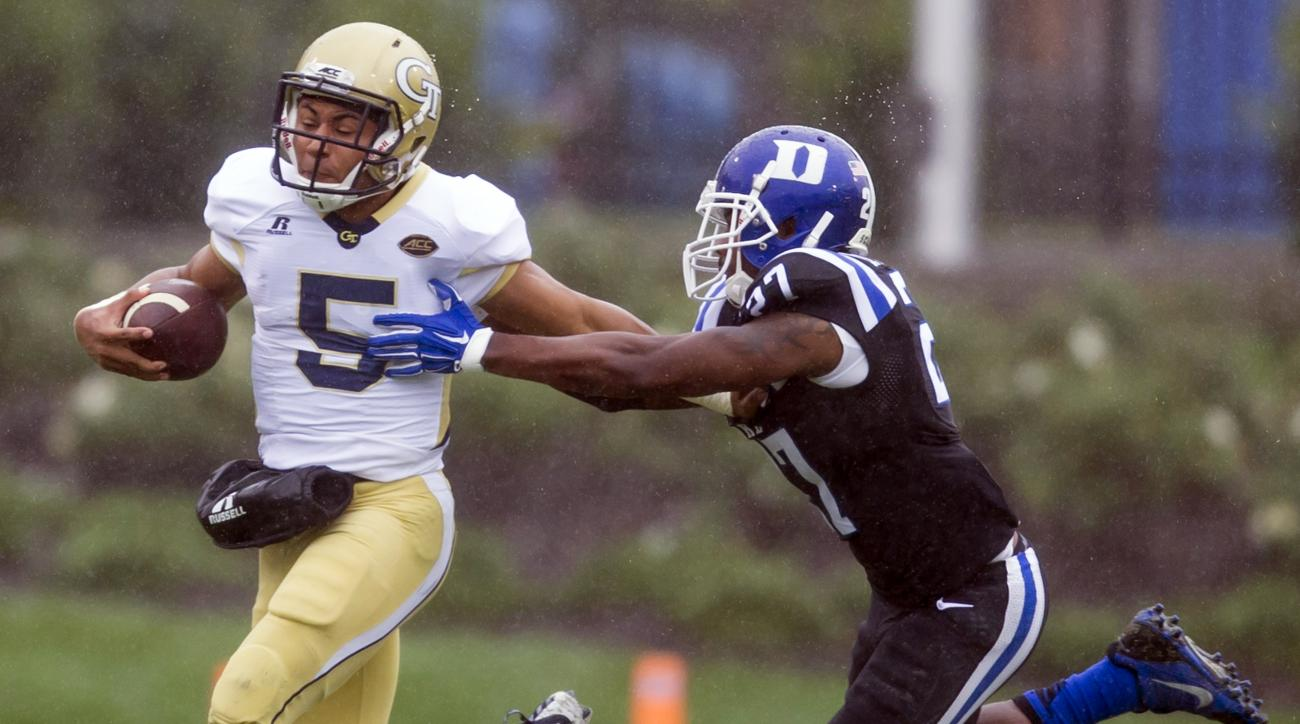 Georgia Tech quarterback Justin Thomas, left, runs for a long gain before being tackled by Duke's DeVon Edwards, right, during the first half of an NCAA college football game, in Durham, N.C., Saturday, Sept. 26, 2015. (AP Photo/Rob Brown)