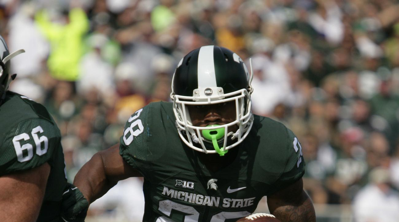 Michigan State's Madre London runs for a touchdown against Central Michigan during the first quarter of an NCAA college football game, Saturday, Sept. 26, 2015, in East Lansing, Mich. (AP Photo/Al Goldis)