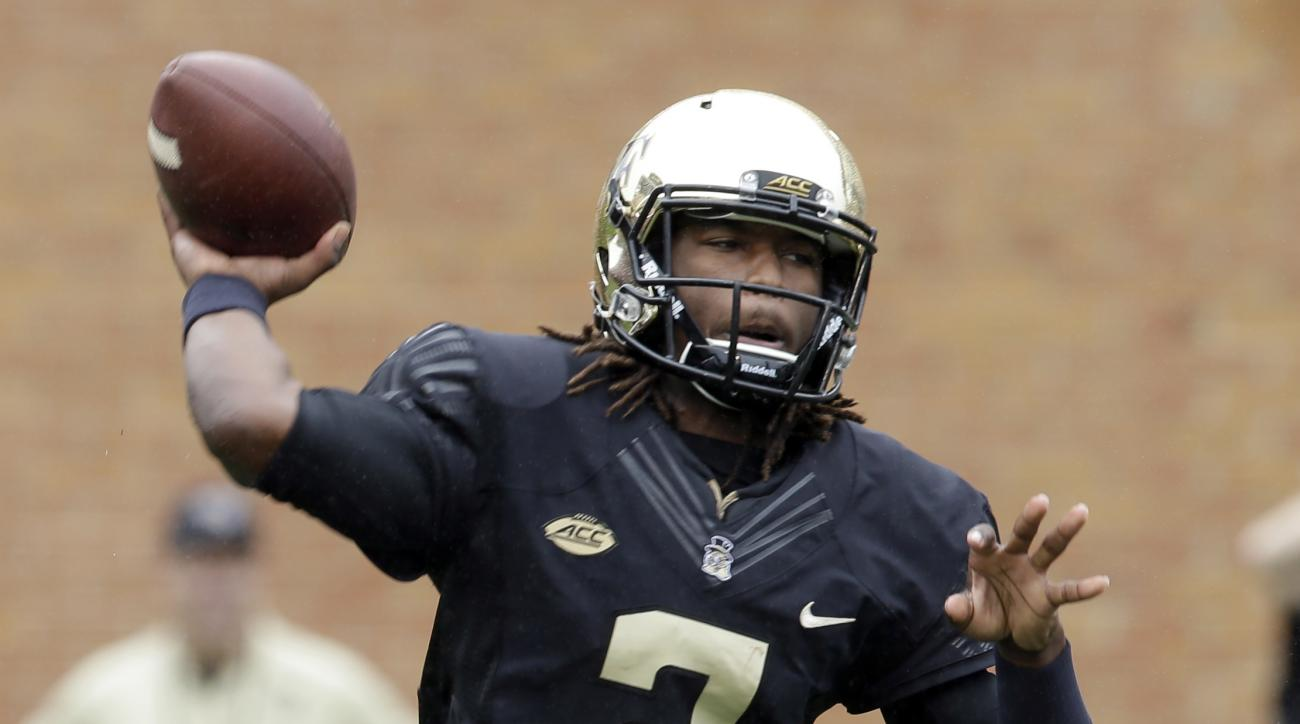 Wake Forest's Kendall Hinton (2) prepares to throw a pass against Indiana during the first half of an NCAA college football game in Winston-Salem, N.C., Saturday, Sept. 26, 2015. (AP Photo/Chuck Burton)