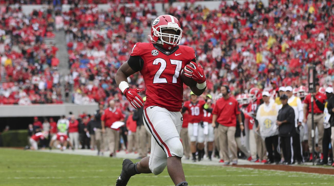 Georgia running back Nick Chubb (27) runs for a touchdown against Southern in the first half of an NCAA college football game  Saturday, Sept. 26, 2015, in Athens, Ga. Georgia won 48-6. (AP Photo/John Bazemore)