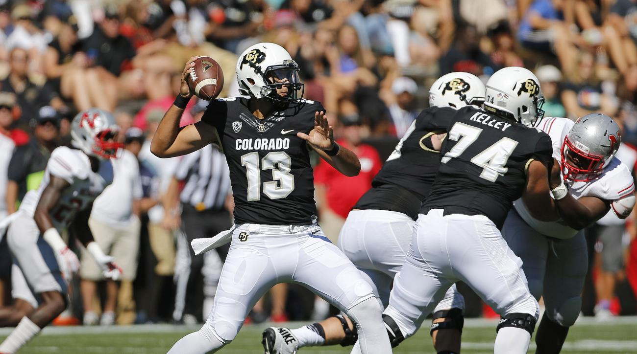 Colorado quarterback Sefo Liufau (13) throws during the first half of an NCAA college football game against Nicholls State in Boulder, Colo., Saturday, Sept. 26, 2015. (AP Photo/Brennan Linsley)
