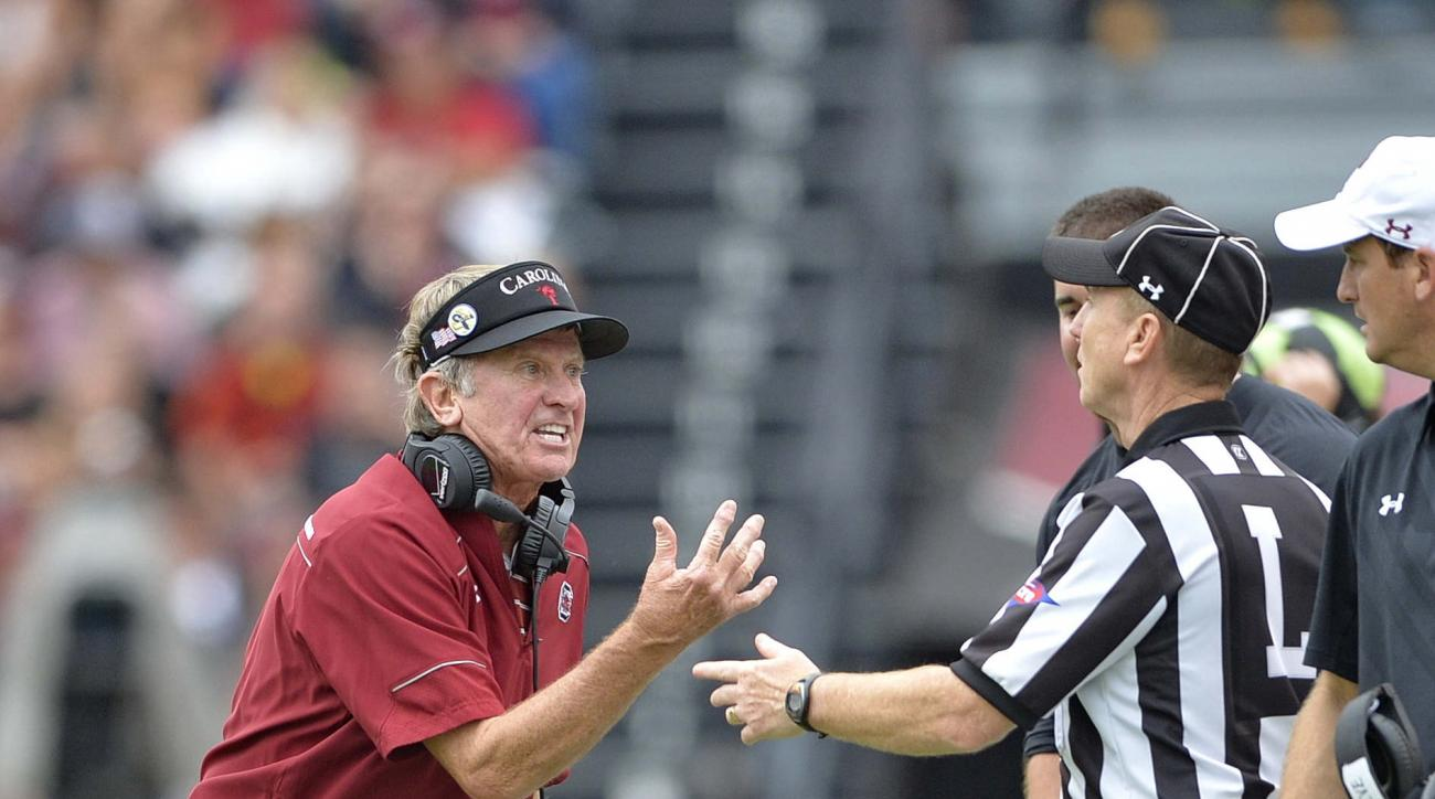 South Carolina head coach Steve Spurrier argues a call with an official during the second half of an NCAA college football  game against Central Florida, Saturday, Sept. 26, 2015,  in Columbia, S.C. South Carolina won 31-14. (AP Photo/Richard Shiro)