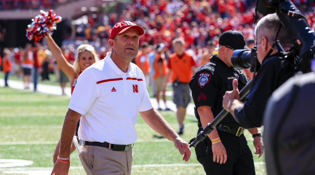 Nebraska head coach Mike Riley looks at the scoreboard as he walks off the field following an NCAA college football game against Southern Miss in Lincoln, Neb., Saturday, Sept. 26, 2015. Nebraska won 36-28. (AP Photo/Nati Harnik)