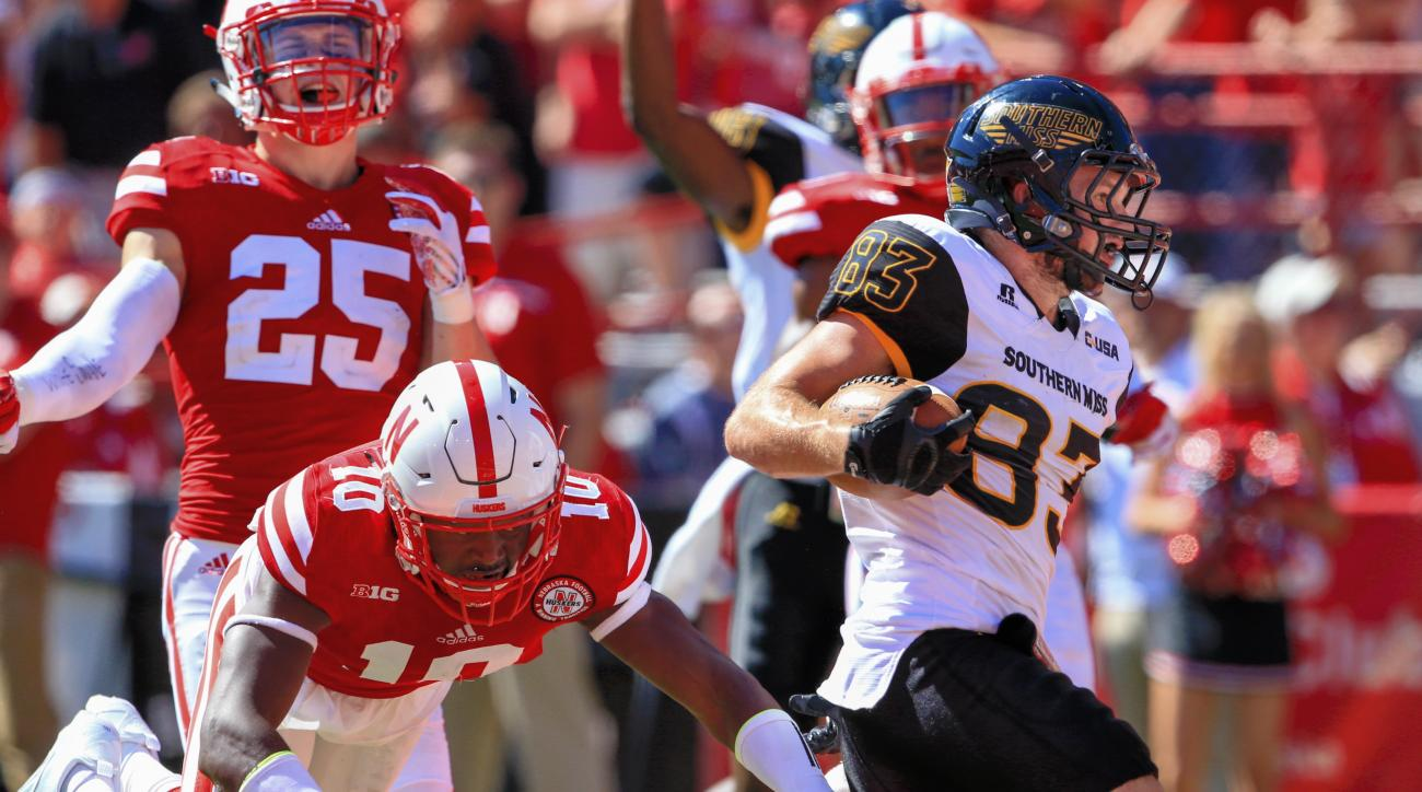 Southern Miss wide receiver Casey Martin (83) runs for a touchdown ahead of Nebraska cornerback Joshua Kalu (10) and safety Nate Gerry (25) during the second half of an NCAA college football game in Lincoln, Neb., Saturday, Sept. 26, 2015. Nebraska won 36