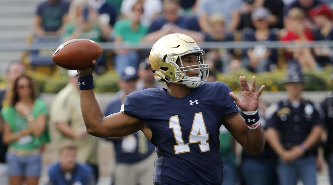 Notre Dame's DeShone Kizer drops back to pass during the first half of an NCAA college football game against Massachusetts, Saturday, Sept. 26, 2015, in South Bend, Ind. (AP Photo/Charles Rex Arbogast)