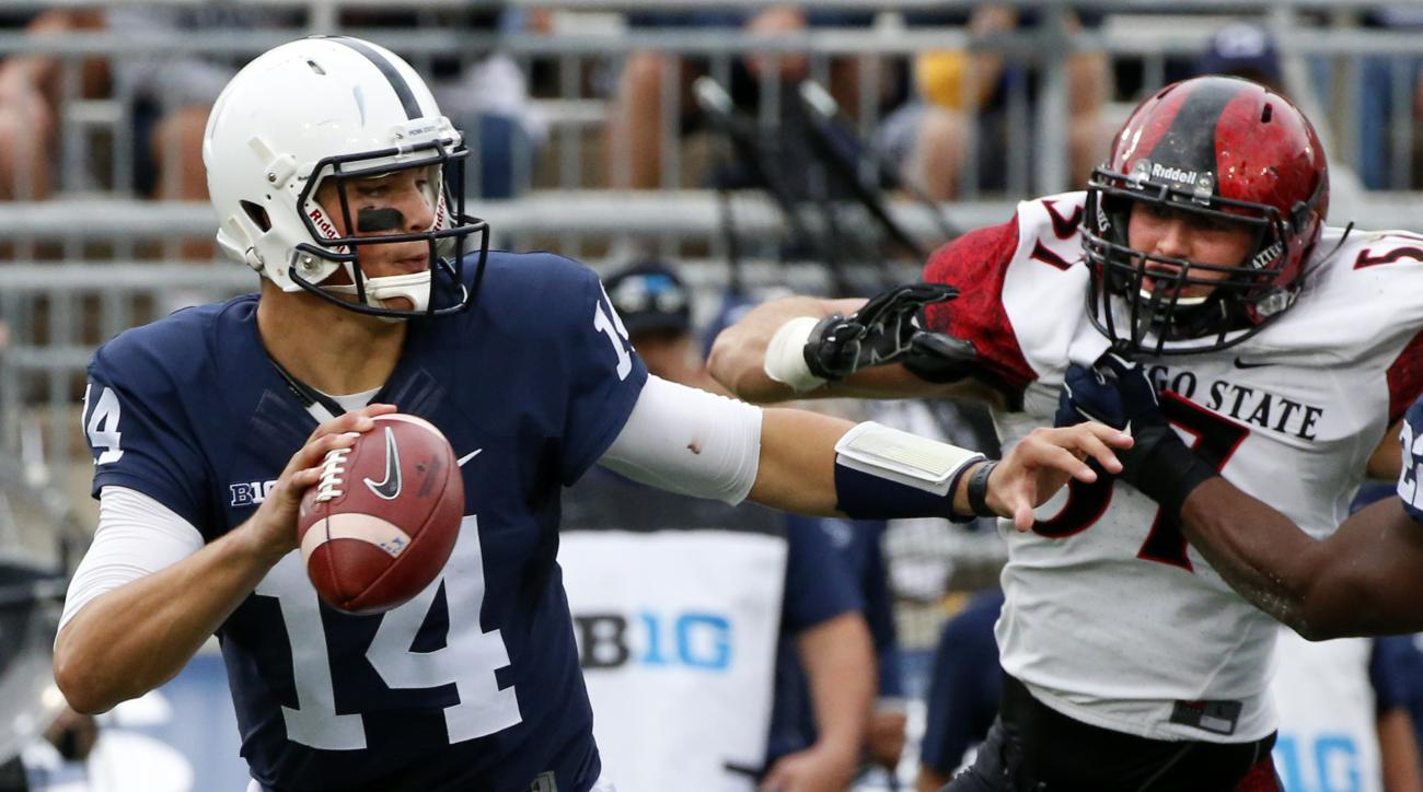 Penn State Nittany Lions quarterback Christian Hackenberg (14) looks to pass under pressure from San Diego State linebacker Ryan Dunn (57) during the first half of an NCAA college football game in State College, Pa., Saturday, Sept. 26, 2015. (AP Photo/Ge
