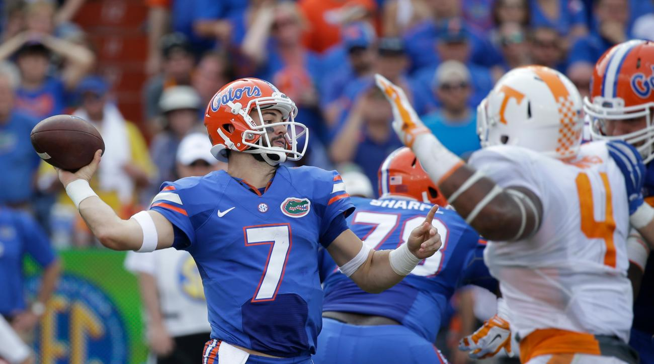 Florida quarterback Will Grier (7) throws a pass as he is pressured by Tennessee defensive lineman LaTroy Lewis (4) during the first half of an NCAA college football game, Saturday, Sept. 26, 2015, in Gainesville, Fla. (AP Photo/John Raoux)
