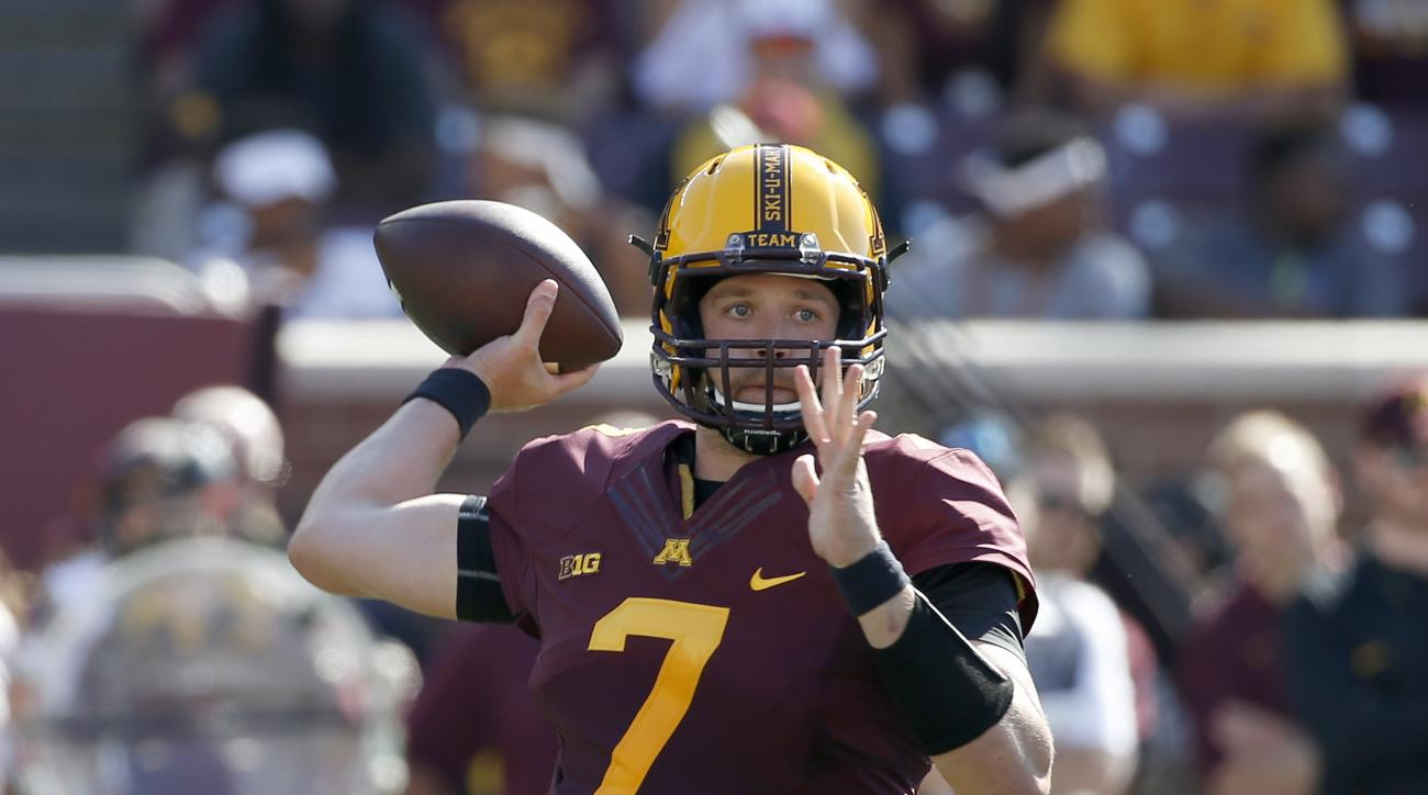 Minnesota quarterback Mitch Leidner (7) throws a pass during the first half of an NCAA college football game against Ohio in Minneapolis Saturday, Sept. 26, 2015. (AP Photo/Ann Heisenfelt)