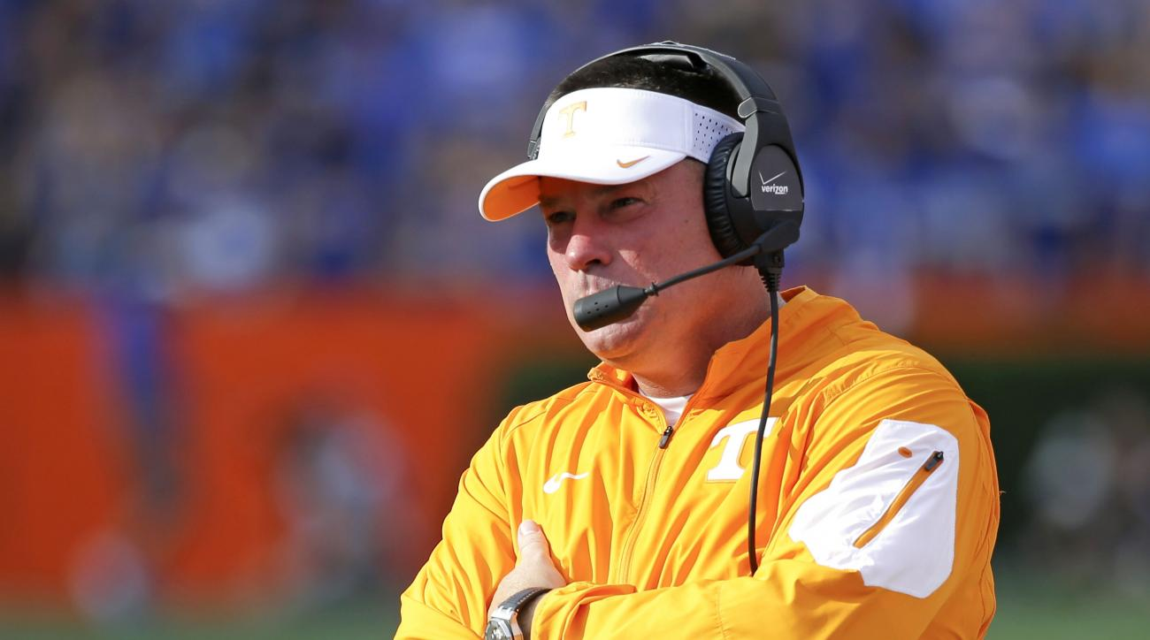 Tennessee head coach Butch Jones watches his team during the first half of an NCAA college football game against Florida, Saturday, Sept. 26, 2015, in Gainesville, Fla. (AP Photo/John Raoux)