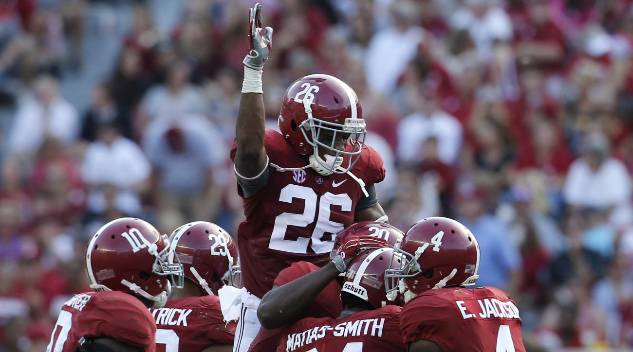Alabama defensive back Geno Matias-Smith (24) celebrates his interception during the first half of an NCAA college football game against Louisiana Monroe in Tuscaloosa, Ala., Saturday, Sept. 26, 2015. (AP Photo/Jonathan Bachman)