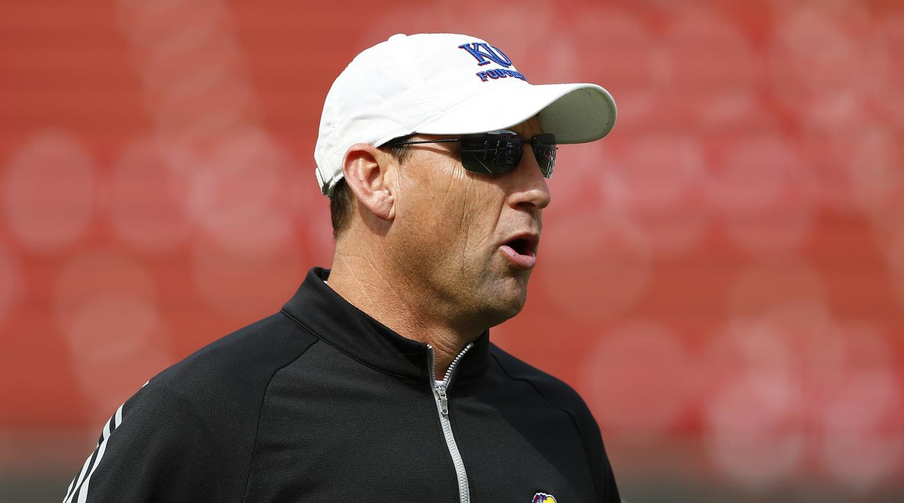 CORRECTS DATE TO SEPT. 26, NOT SEPT. 27 - Kansas head coach David Beaty watches warm-ups before an NCAA college football game against Rutgers, Saturday, Sept. 26, 2015, in Piscataway, N.J. (AP Photo/Rich Schultz)