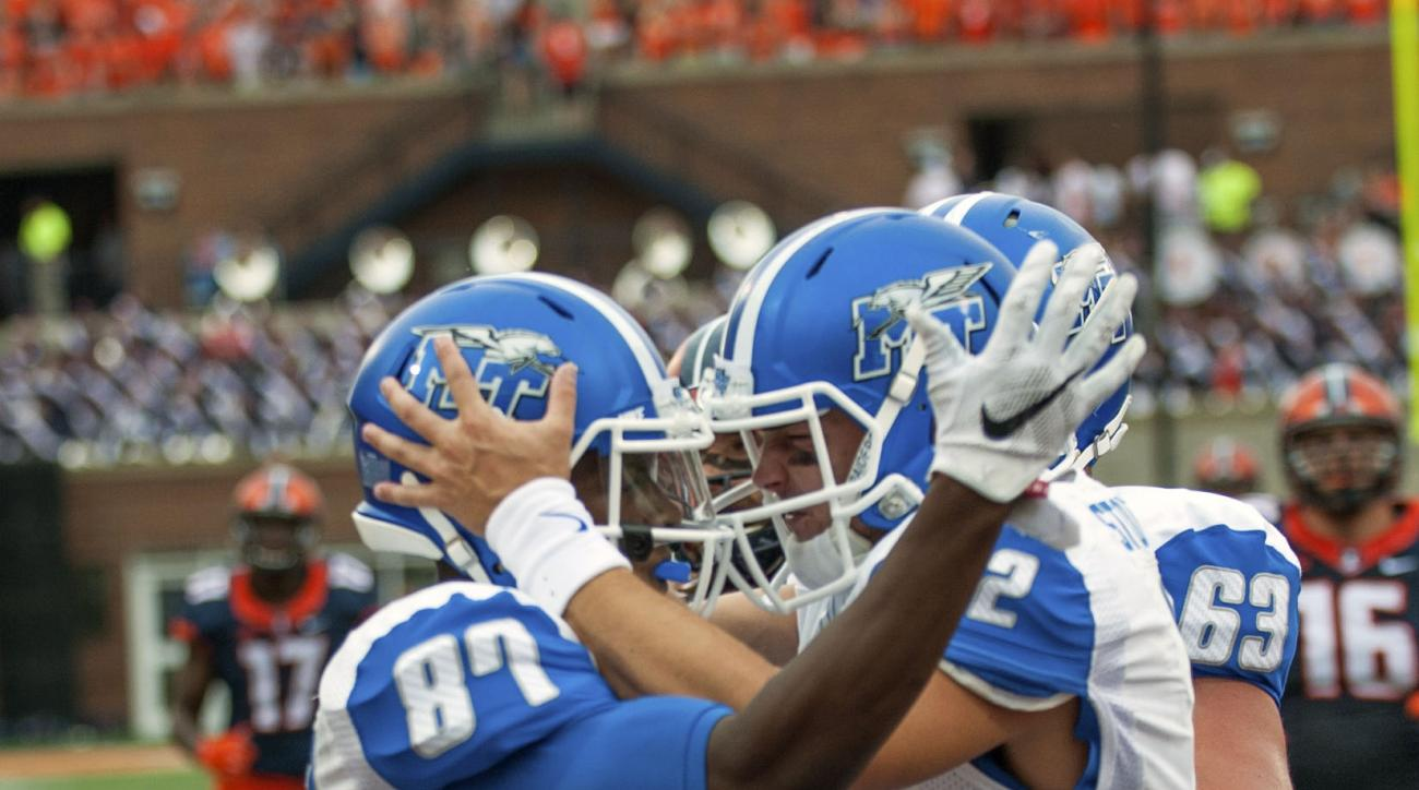 Middle Tennessee quarterback Brent Stockstill (12) congratulates Middle Tennessee wide receiver Richie James (87) after James caught a touchdown pass from Stockstill during the second quarter of an NCAA football game Saturday, Sept. 26, 2015 at Memorial S