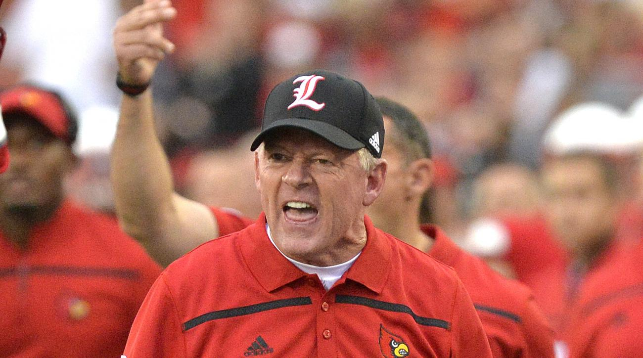 Louisville coach Bobby Petrino shouts instructions to his team during the first half of an NCAA college football game against Samford, Saturday, Sept. 26, 2015, in Louisville, Ky. (AP Photo/Timothy D. Easley)