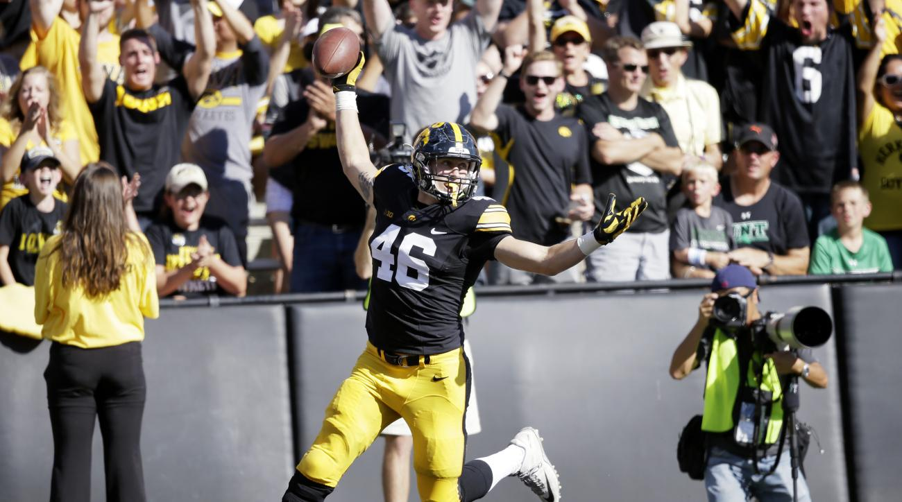 Iowa tight end George Kittle celebrates as he scores on a 43-yard touchdown reception during the first half of an NCAA college football game against North Texas, Saturday, Sept. 26, 2015, in Iowa City, Iowa. Iowa won 62-16. (AP Photo/Charlie Neibergall)