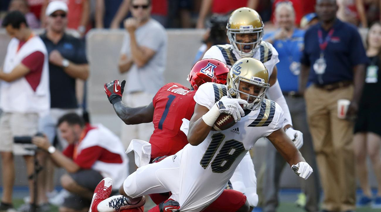 UCLA wide receiver Thomas Duarte scores a touchdown during the first half of an NCAA college football game against Arizona, Saturday, Sept. 26, 2015, in Tucson, Ariz. (AP Photo/Rick Scuteri)