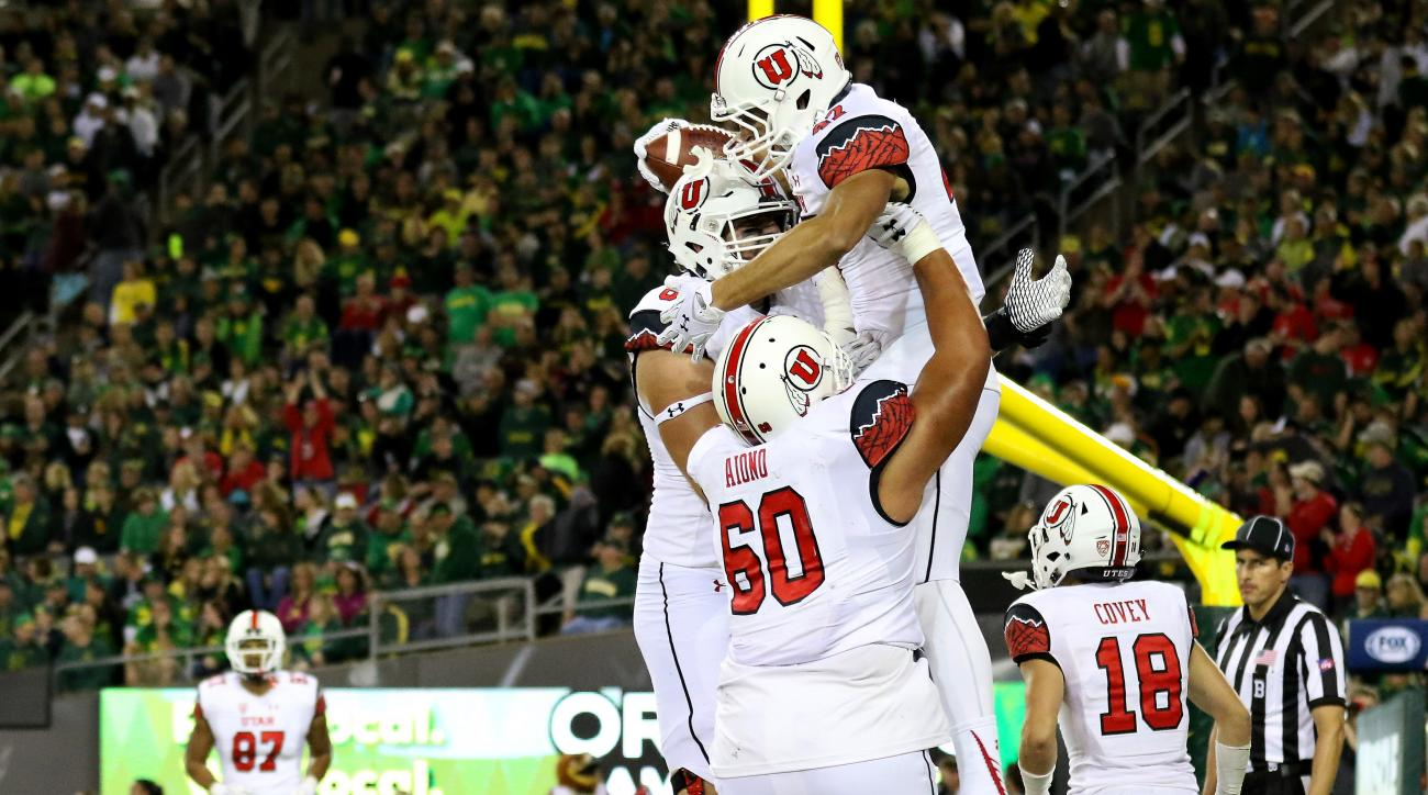 Utah tight end Caleb Repp (47) celebrates with teammates after scoring a touchdown during the second half of an NCAA college football game against Oregon, Saturday, Sept. 26, 2015, in Eugene, Ore. (AP Photo/Ryan Kang)