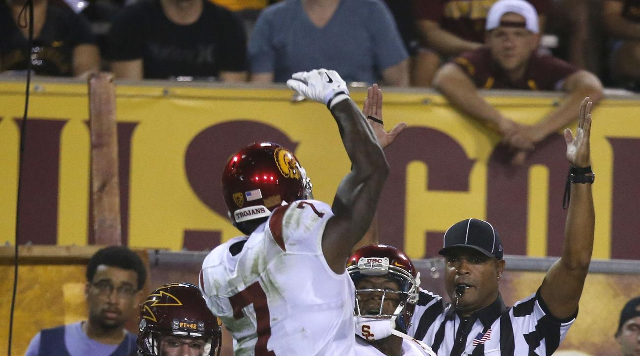 Southern California's JuJu Smith-Schuster (9) celebrates his touchdown with Steven Mitchell Jr. (7) as Arizona State's Jordan Simone (38) looks away during the first half of an NCAA college football game Saturday, Sept. 26, 2015, in Tempe, Ariz. (AP Photo