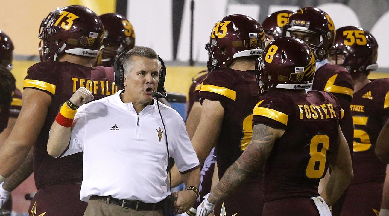 Arizona State head coach Todd Graham, left, talks with D.J. Foster (8) on the sidelines during the second half of an NCAA college football game against Southern California Saturday, Sept. 26, 2015, in Tempe, Ariz. Southern California defeated Arizona Stat