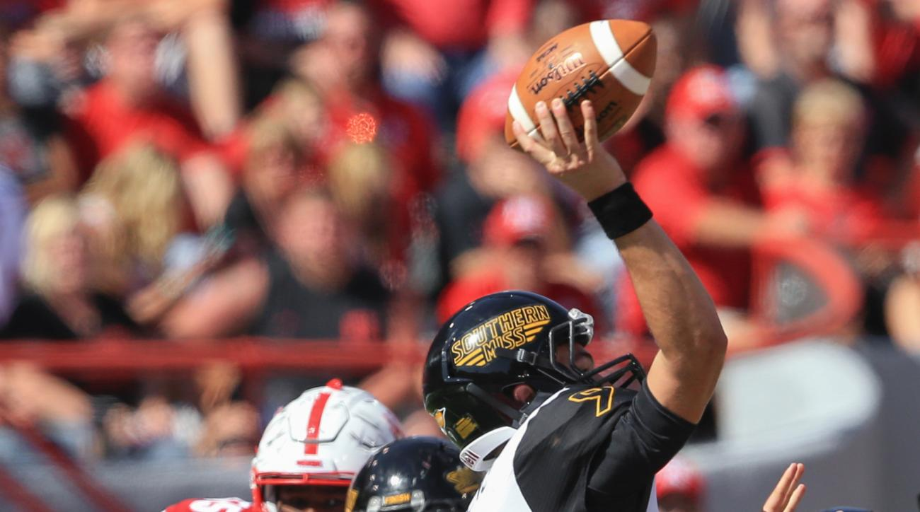 In this Saturday,  Sept. 26, 2015, photo, Nebraska defensive end Freedom Akinmoladun, second from left, and defensive tackle Kevin Maurice (55) close in on Southern Mississippi quarterback Nick Mullens (9) during the second half of an NCAA college footbal