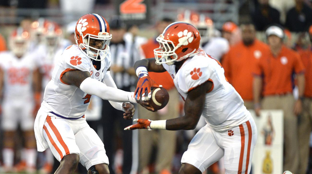 FILE - In this Sept. 17, 2015 file photo, Clemson quarterback Deshaun Watson, left, hands the ball off to Wayne Gallman during the first half of an NCAA college football game against Louisville in Louisville, Ky. Clemson takes on No. 6 Notre Dame this Sat