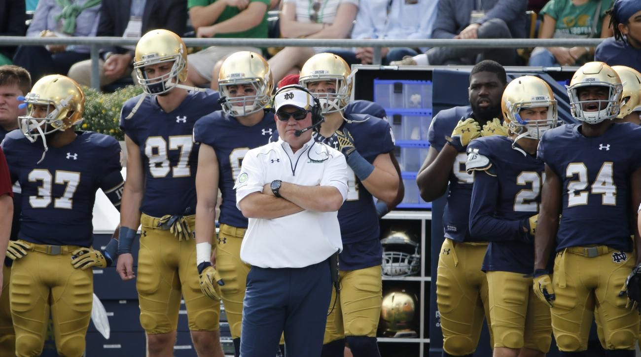 FILE - In this Sept. 26, 2015 file photo, Notre Dame head coach Brian Kelly watches his team from the sidelines during the first half of an NCAA college football game against Massachusetts in South Bend, Ind. Notre Dame won 62-27.  The question facing six