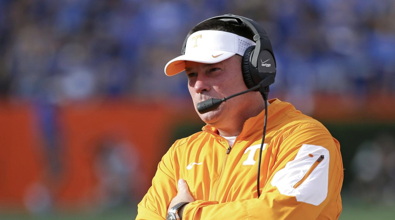 FILE - In this Sept. 26, 2015 file photo, Tennessee head coach Butch Jones watches his team during the first half of an NCAA college football game against Florida in Gainesville, Fla. After his team blew fourth-quarter leads in two of its last three games
