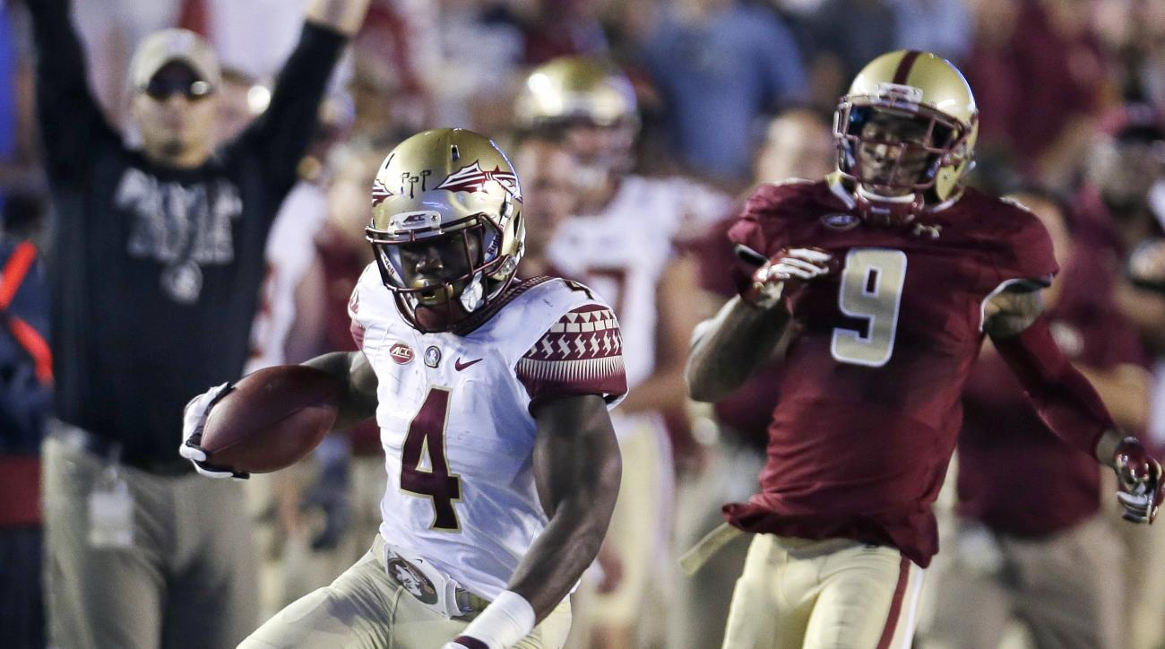 FILE - In this Sept. 18, 2015, file photo, Florida State running back Dalvin Cook (4) tries to outrun Boston College defensive back Justin Simmons (27) and defensive back John Johnson (9) during the first half of an NCAA college football game in Boston. O