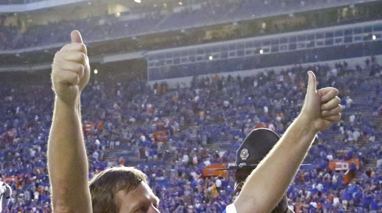FILE - In this Sept. 26, 2015, file photo, Florida head coach Jim McElwain gives the thumbs up to fans after defeating Tennessee 28-27 in an NCAA college football game in Gainesville, Fla. Rejuvenated Florida (4-0, 2-0) slipped back into the rankings this
