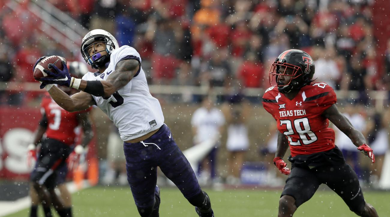 FILE - In this Sept. 26, 2015, file photo,l TCU wide receiver Josh Doctson (9) catches a pass in front of Texas Tech defensive back Paul Banks (28) during the first half of an NCAA college football game in Lubbock, Texas. Baylor, West Virginia, Texas Tech