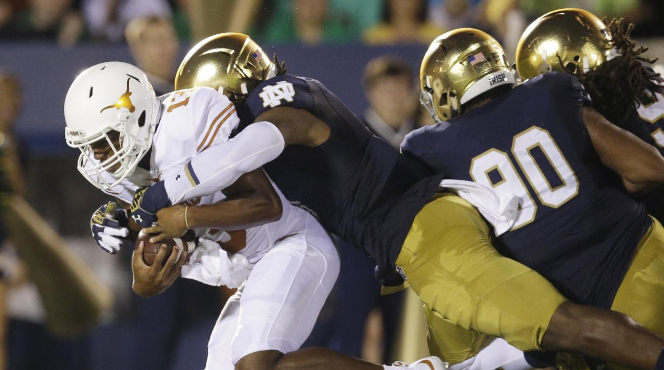 FILE - In this Sept. 5, 2015, file photo, Notre Dame linebacker Jaylon Smith, center, sacks Texas quarterback Jerrod Heard, left, during the first half of an NCAA college football game in South Bend, Ind. Notre Dame linebacker Jaylon Smith is hard to keep