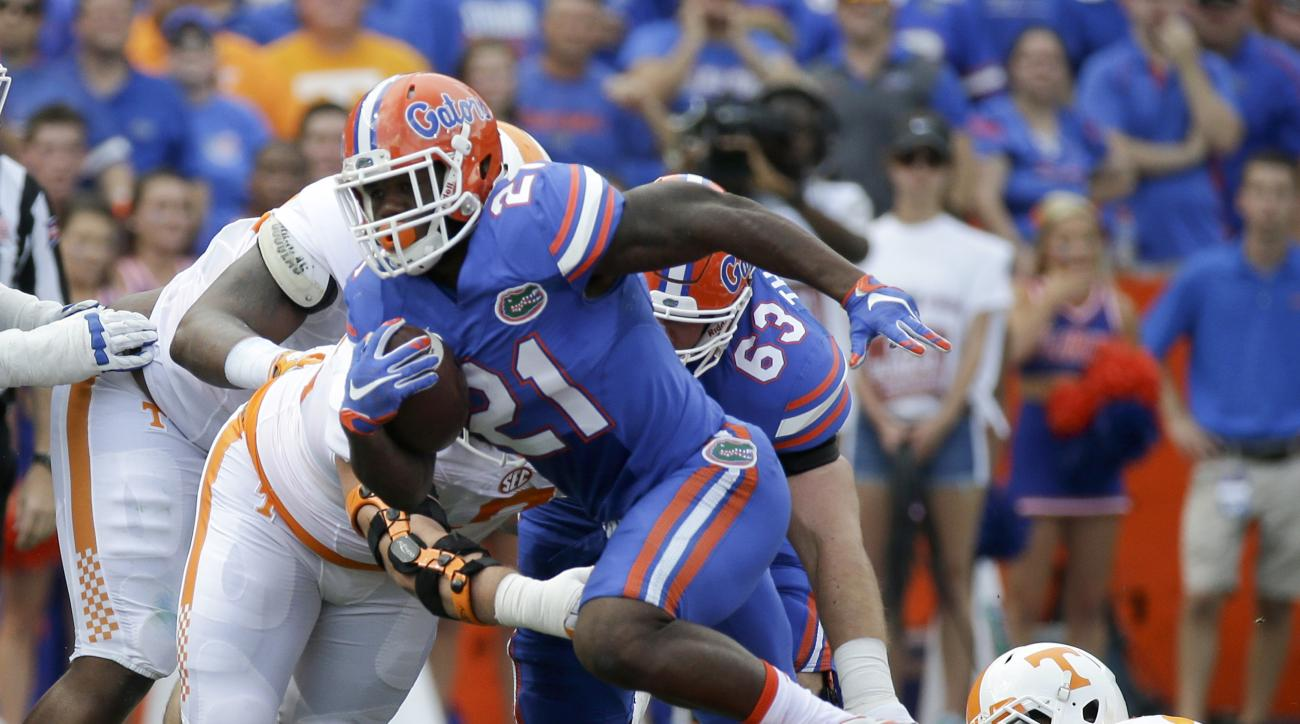 FILE - In this Sept. 26, 2015, file photo, Florida running back Kelvin Taylor (21) runs against Tennessee during the first half of an NCAA college football game in Gainesville, Fla. Kelvin Taylor was publicly ripped and then benched following a throat-sla