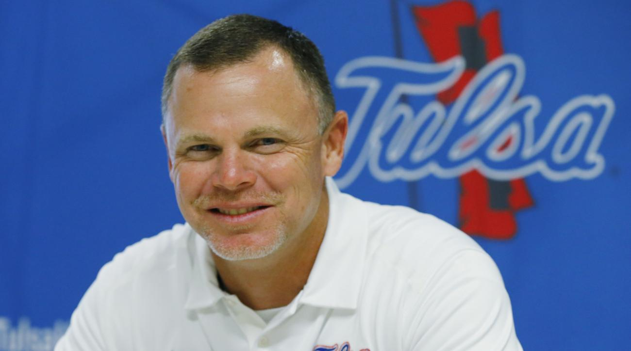 FILE - In this Aug. 11, 2015, file photo, Tulsa head coach Philip Montgomery smiles during Tulsa NCAA college football media day in Tulsa, Okla. First-year Tulsa coach Philip Montgomery is no stranger to the new millennium's brand of high-scoring football