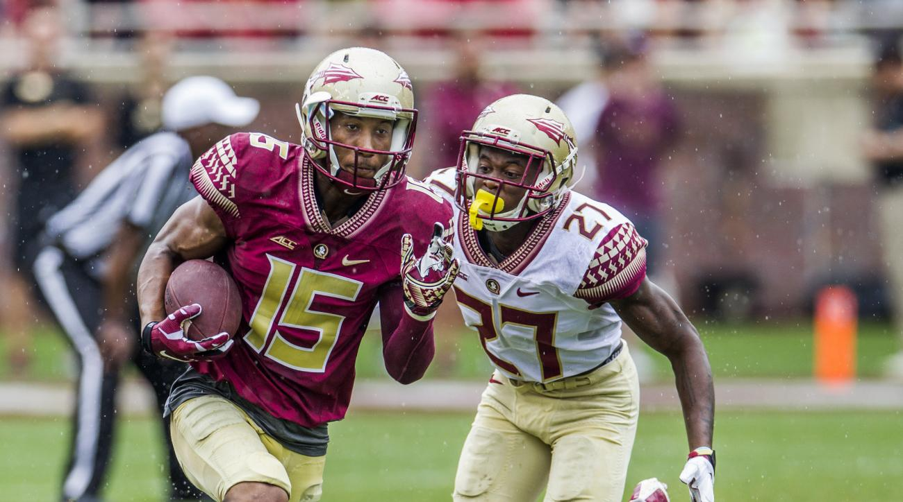 FILE - In this April 11, 2015, file photo, Florida State wide receiver Travis Rudolph, left, outruns  cornerback Marquez White in the first half of Florida State Garnet & Gold spring college football game in Tallahassee, Fla. Florida State's receivers, wh
