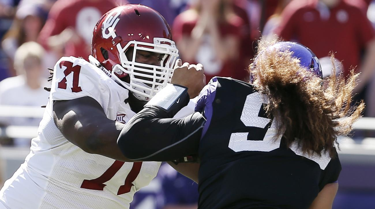 Oklahoma offensive tackle Tyrus Thompson (71) blocks TCU defensive end Mike Tuaua (93) during the first half of a NCAA college football game at Amon G. Carter Stadium, Saturday, Oct. 4, 2014, in Fort Worth, Texas. TCU won 37-33. (AP Photo/Brandon Wade)