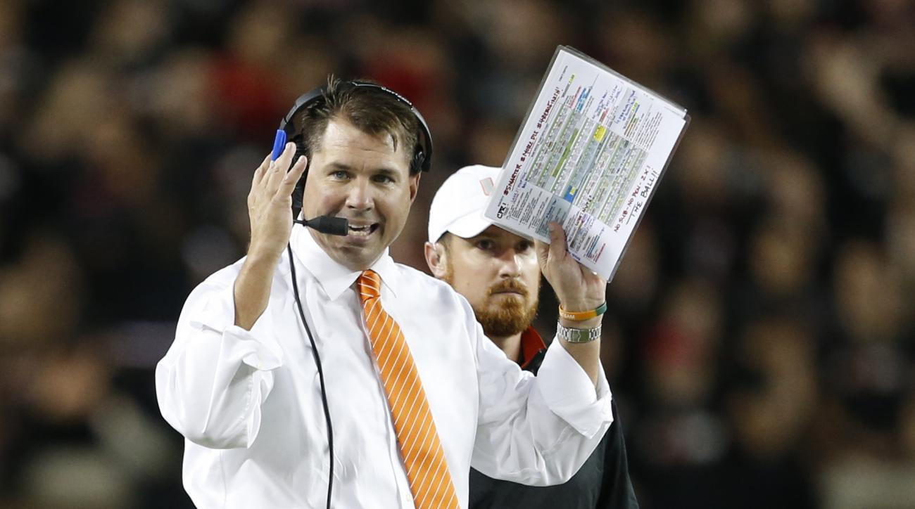 Miami head coach Al Golden gives instructions during the first half of an NCAA college football game against Cincinnati, Thursday, Oct. 1, 2015, in Cincinnati. (AP Photo/Gary Landers)